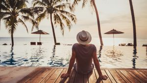Vacation Fund 300x169 - Holidays, tourist relaxing in luxury beach hotel near luxurious swimming pool.